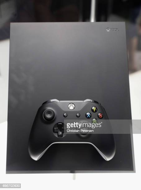 The upcoming 'XBox One X' is displayed during the Electronic Entertainment Expo E3 at the Los Angeles Convention Center on June 13 2017 in Los...