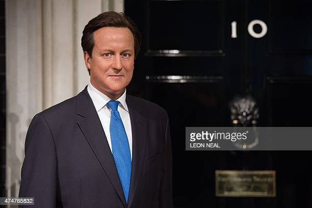The updated wax figure of British Prime Minister David Cameron is seen at Madame Tussauds in central London on May 26 2015 With signs of grey hair...
