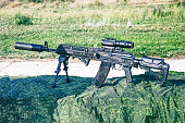 The upgraded Kalashnikov AK47 assault rifle on bipods with tactical accessories, an optical sight and a silencer