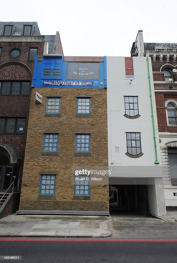 'The Upside Down House' by Artist Alex Chinneck is launched to the media. The installation, on Blackfriars Road, has been turned upside down to celebrate the history of the building on December 4, 2013 in London, England.