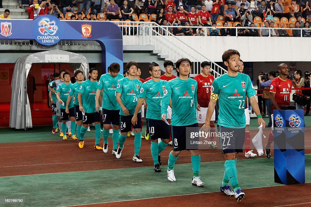 The Urawa Red Diamonds team walk out onto the pitch before the AFC Champions League Group F match between Guangzhou Evergrande and Urawa Red Diamonds at Tianhe Stadium on February 26, 2013 in Guangzhou, China.