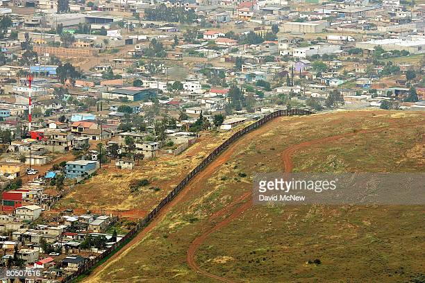 The urban landscape of Tijuana Mexico ends abruptly at the USMexico on April 3 2008 in the Otay Mountain Wilderness Area southeast of Chula Vista...