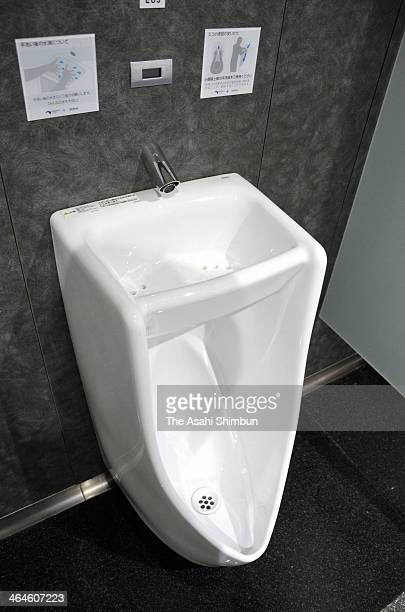 The urinal having a water basin at the top is placed at a toilet of the the Otsu Service Area on the Meishin Expressway on January 8 2014 in Otsu...