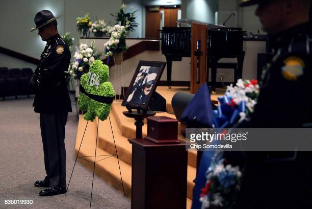 The urn box containing the remains of Virginia State Police TrooperPilot Berke MM Bates is guarded by fellow troopers during his funeral at Saint...