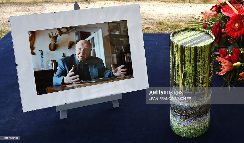 The urn of late Georges Seguy former secretary general of the French trade union CGT is displayed next to a picture during the funeral at the...