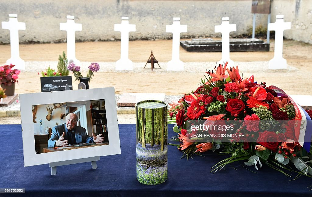 The urn of late Georges Seguy former secretary general of the French trade union CGT is displayed next to a picture and a wreath during the funeral...