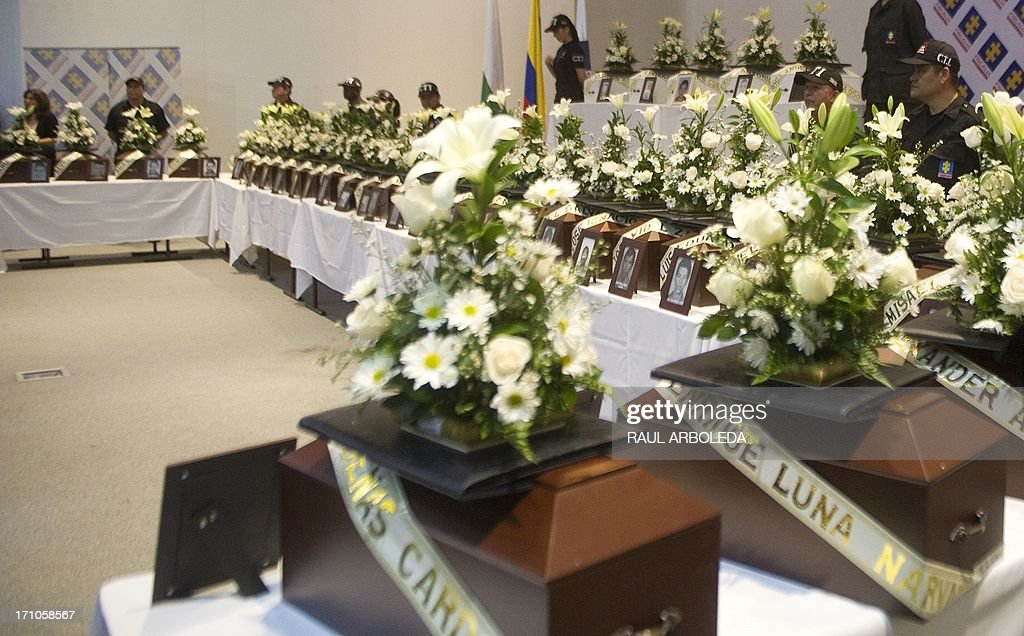 The urns with the remains of people disappeared during the Colombian civil war until recently, on June 21, 2013 in Medellin, Antioquia department, Colombia. In a ceremony, relatives of 36 victims received the remains of their loved ones, which were recently found in common graves due to information given by demobilized combatants of both, leftist guerrillas and right-wing paramilitary groups, in the framework of the country's peace process. AFP PHOTO/Raul ARBOLEDA