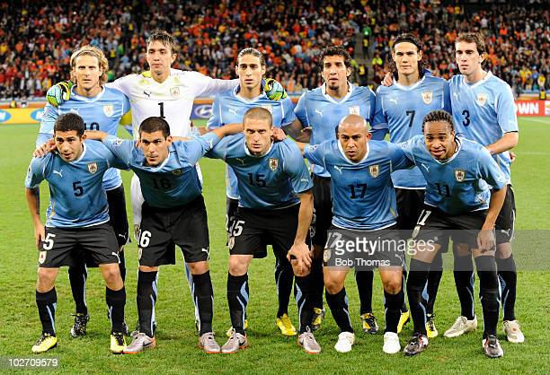 The Uruguay team pose for a team group prior to the start of the 2010 FIFA World Cup South Africa Semi Final match between Uruguay and the...