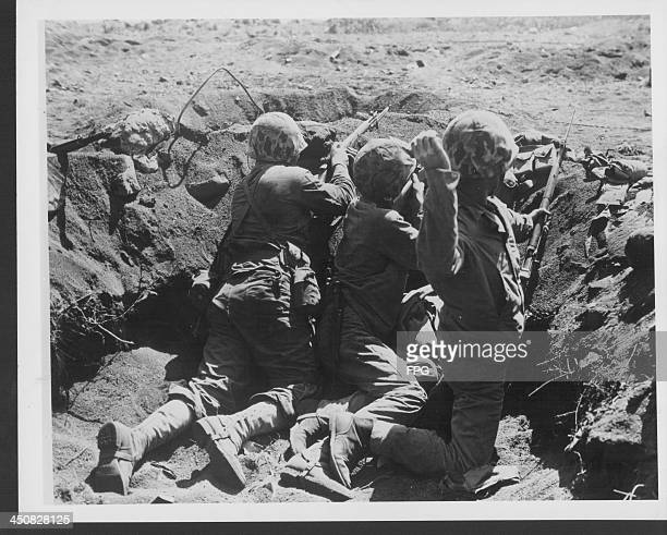 The US 4th Marine Division at the Battle of Iwo Jima three marines in a foxhole during battle World War Two Japan March 1st 1945