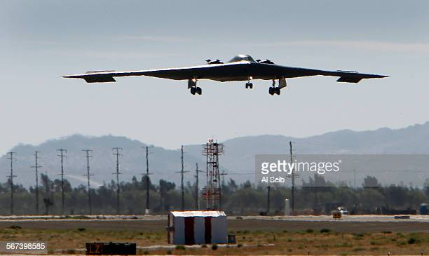 PALMDALE CA JULY 17 2014 The US Air Force's B2 Spirit Stealth bomber 'Spirit of Arizona' lands at the Northrop Grumman Corp facility at US Air Force...