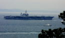 The US aircraft carrier Kitty Hawk sails off its home port at the US naval base September 21 2001 in Yokosuka south of Tokyo Japan escorted by ships...