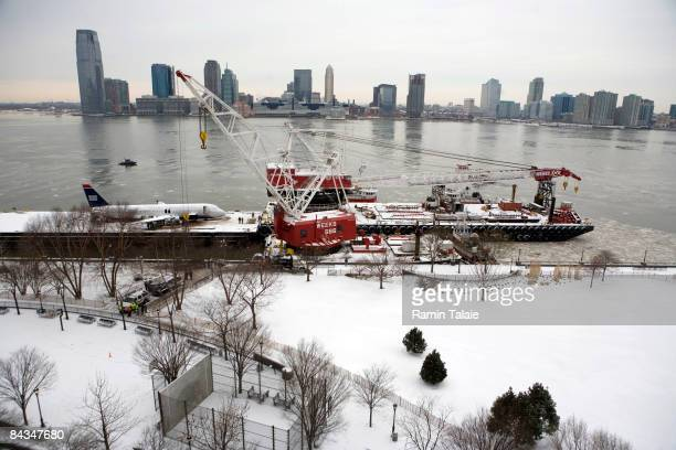 The US Airways Airbus A320 rests on a barge after it was lifted out of the Hudson River January 18 2009 in New York City US Airways Flight 1549...