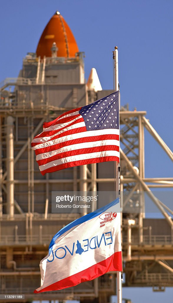 The U.S. and Endeavour Shuttle flags fly at the launch pad at the John F. Kennedy Space Center April 30, 2011 in Cape Canaveral, Florida. NASA put the launch of the Space Shuttle Endeavour off until at least May 2, as repair efforts are underway for a thermostat malfunction on Space Shuttle Endeavour, which caused a scrub of yesterday's launch attempt. This will be Endeavour's final trip to the International Space Station.