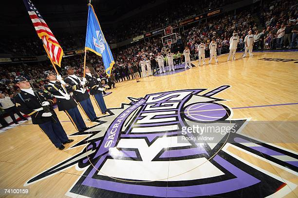 The US Army color guard stand at attention during the National Anthem before the NBA game between the Los Angeles Lakers and the Sacramento Kings at...