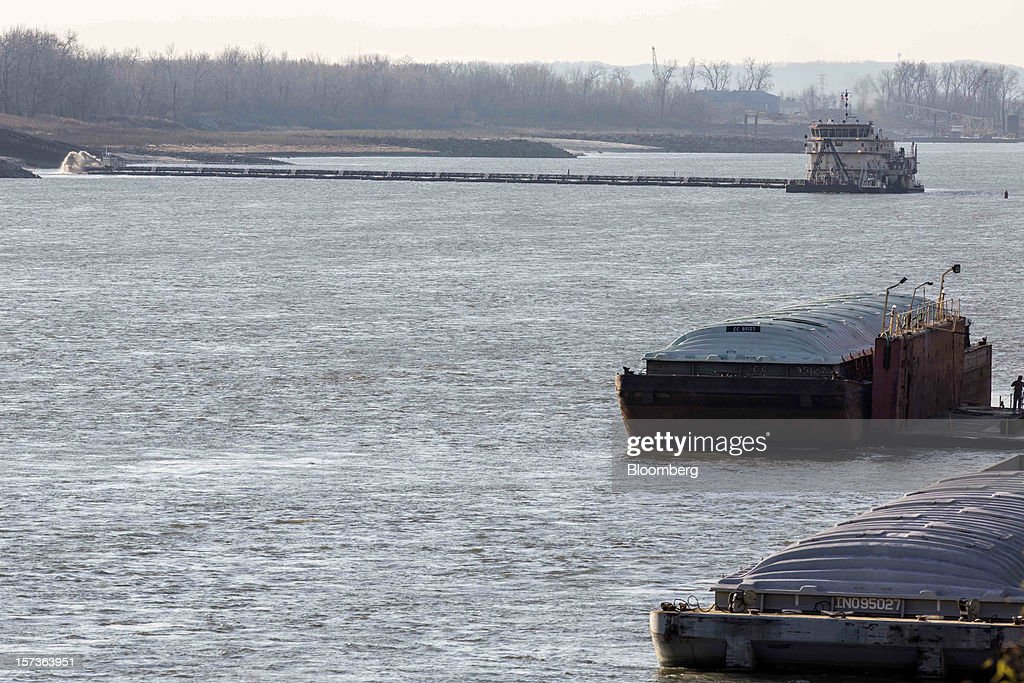 The U.S. Army Corps of Engineers, background, dredges the Mississippi River several miles south of downtown St. Louis, Missouri, U.S. on Friday, Nov. 30, 2012. The Army Corps of Engineers is dredging downstream from the Bussen Terminal, hauling up silt to keep the channels as open as possible. Photographer: Whitney Curtis/Bloomberg via Getty Images