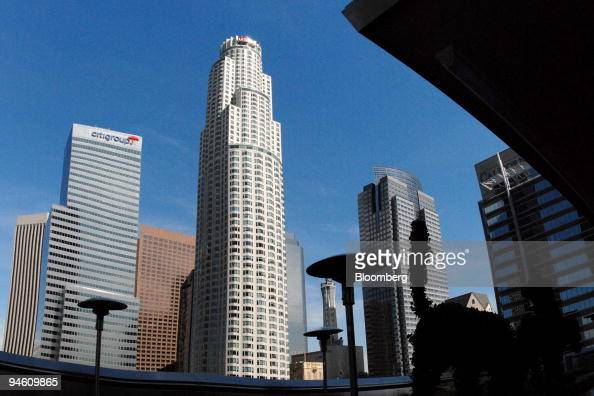 The us bank tower owned by maguire properties inc stands above the