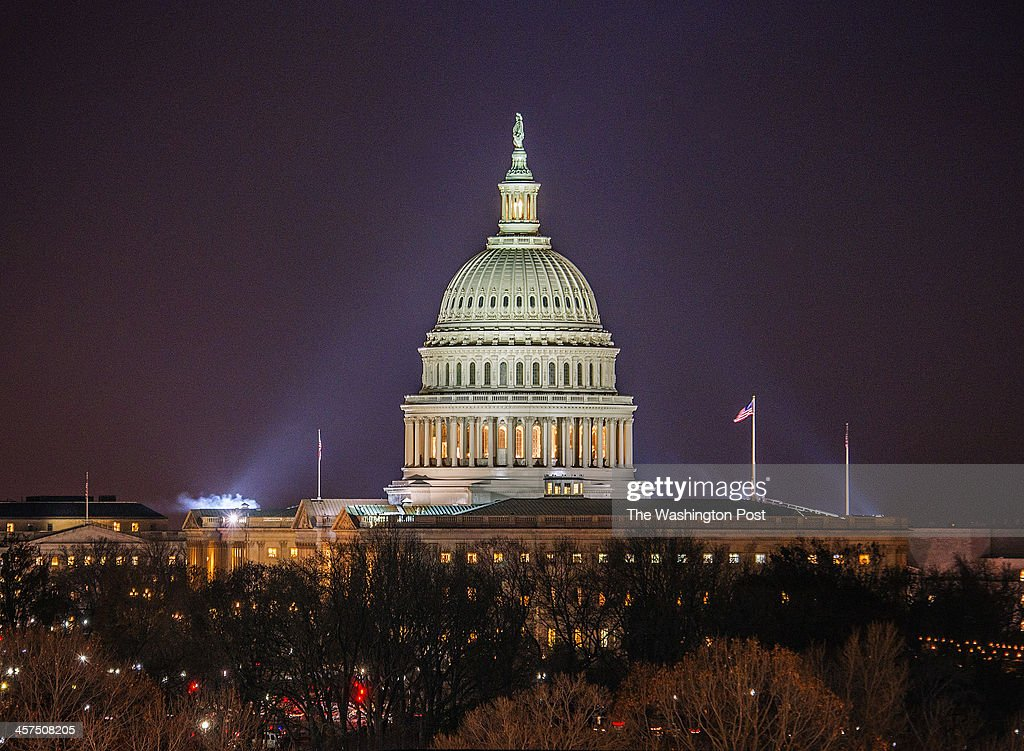 The US Capitol building at night on December 2013 in Washington DC
