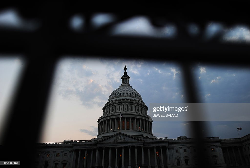The US Capitol Building is pictured at dusk in Washington DC on July 29 2011 Spurred on by President Barack Obama US lawmakers set the stage late...