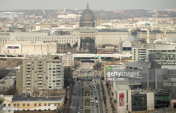 The US Capitol Building on Capitol Hill is seen in this aerial photograph over Washington DC January 15 2015 AFP PHOTO / SAUL LOEB