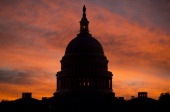 The US Capitol dome is seen at sunrise over Washington DC September 25 2013 The US Senate faces a Sunday showdown over whether to keep government...