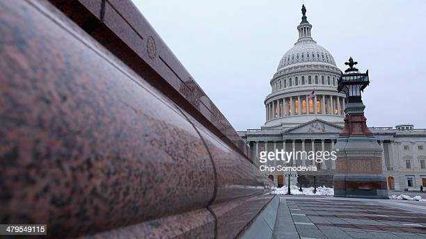 The US Capitol dome is seen before work begins on a twoyear $60 million rnovation of March 19 2014 in Washington DC Curved rows of scaffolds will...