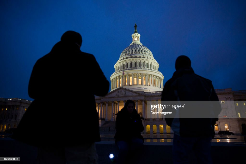 The U.S. Capitol illuminates at dusk on Capitol Hill on December 31, 2012 in Washington, DC. The House and Senate are both still in session on New Year's Eve to try to deal with the looming 'fiscal cliff' issue.
