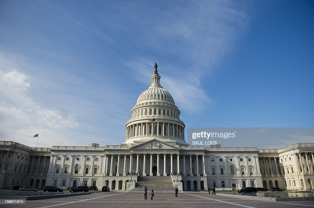 The US Capitol in Washington, DC, on January 2, 2013, on the day after a compromise bill passed the US Congress, avoiding the 'fiscal cliff.' The agreement raises taxes on the rich and puts off aut...
