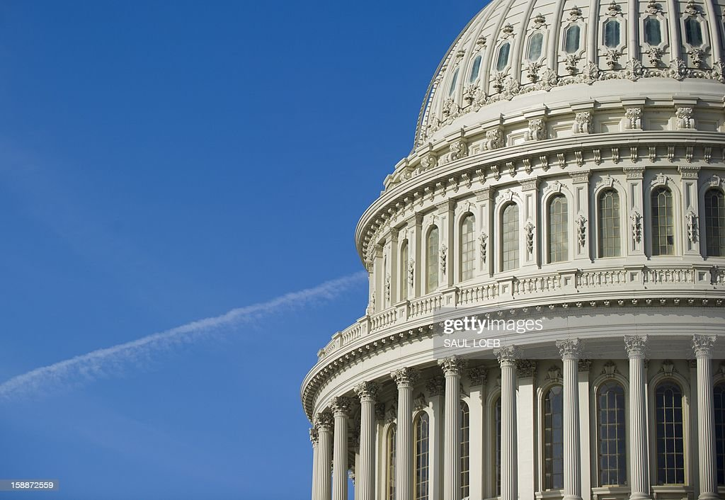 The US Capitol in Washington, DC, on January 2, 2013, on the day after a compromise bill passed the US Congress, avoiding the 'fiscal cliff.' The agreement raises taxes on the rich and puts off automatic $109 billion federal budget cuts for two months. AFP PHOTO / Saul LOEB