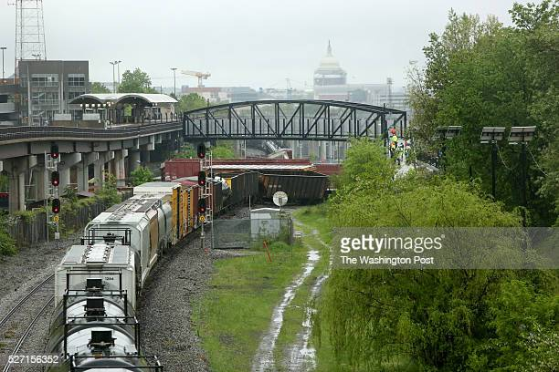 The US Capitol is looms behind the scene of a CSX train derailment near the Rhode Island Ave Metro in NE Washington DC May 1 2016 The 175car train...