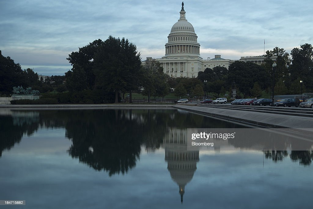 The U.S. Capitol is reflected in the Capitol Reflecting Pool in Washington, D.C., U.S., on Tuesday, Oct. 15, 2013. The House scrapped a vote tonight on a fiscal plan that contains almost none of Republicans' initial conditions for ending the 15 day-old government shutdown and raising the debt ceiling said Representative Pete Sessions, chairman of the House Rules Committee. Photographer: Andrew Harrer/Bloomberg via Getty Images