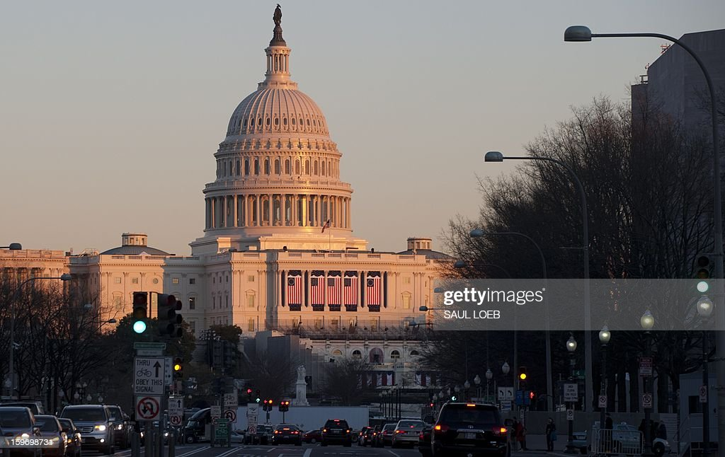 The US Capitol is seen as sunset in Washington, DC, on January 18, 2013, as preparations continue for US President Barack Obama's ceremonial inauguration on January 21. AFP PHOTO / Saul LOEB