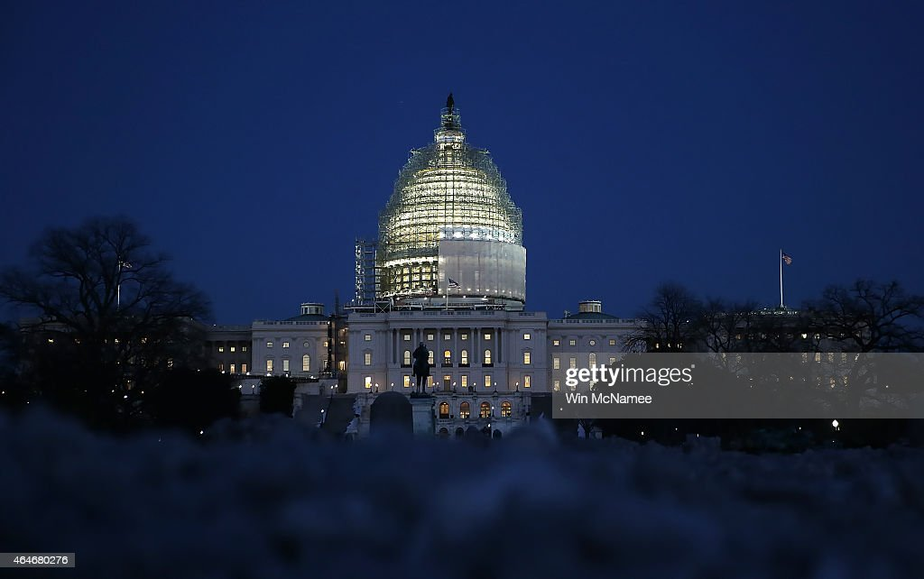 The US Capitol is seen at dusk as the US Congress struggles to find a solution to fund the Department of Homeland Security on February 27 2015 in...