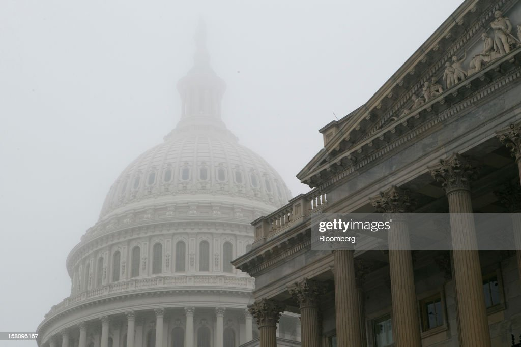 The U.S. Capitol is surrounded by fog in Washington, D.C., U.S., on Monday, Dec. 10, 2012. Lawmakers from both parties are leaving rhetorical room for a split-the-difference agreement with President Barack Obama on a U.S. budget deal . Photographer: Andrew Harrer/Bloomberg via Getty Images