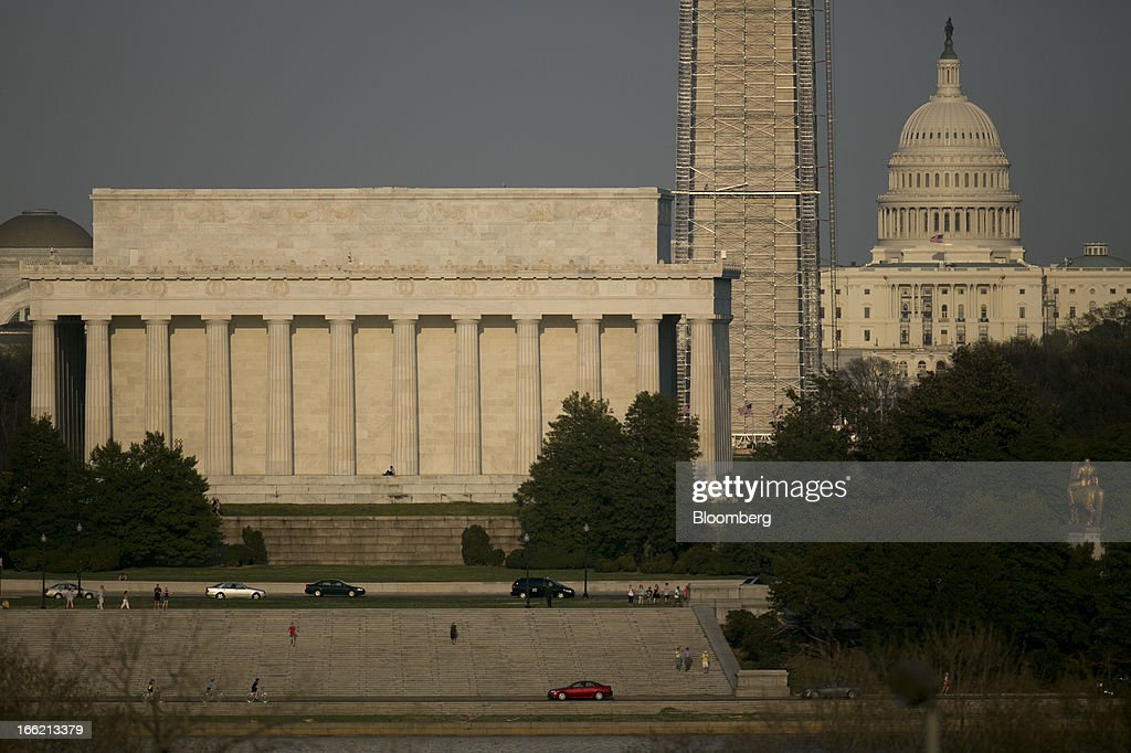 The U.S. Capitol, right, stands behind the Lincoln Memorial, left, and Washington Monument in Washington, D.C., U.S., on Tuesday, April 9, 2013. President Barack Obama sends a $3.77 trillion spending plan to Congress today that calls for reductions in Social Security and Medicare in a political gamble intended to revive deficit-reduction talks. Photographer: Andrew Harrer/Bloomberg via Getty Images