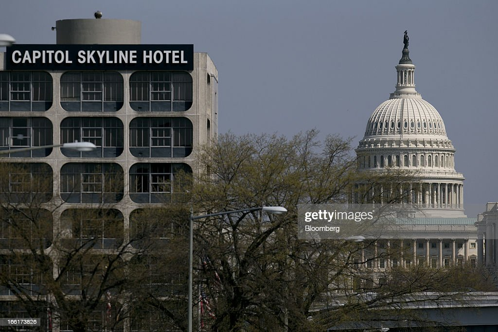 The U.S. Capitol stands behind the Capitol Skyline Hotel in Washington, D.C., U.S., on Tuesday, April 9, 2013. Less than a week after job-creation figures fell short of expectations and underscored the U.S. economy's fragility, President Barack Obama will send Congress a budget that doesn't include the stimulus his allies say is needed and instead embraces cuts in an appeal to Republicans. Photographer: Andrew Harrer/Bloomberg via Getty Images