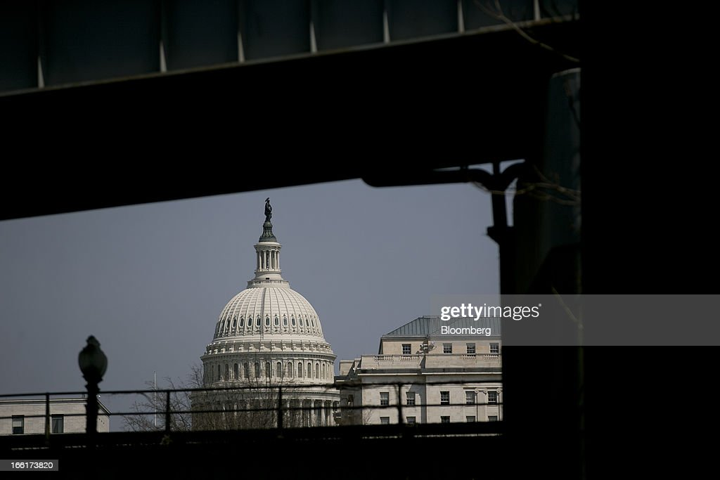 The U.S. Capitol stands behind vehicle ramps in Washington, D.C., U.S., on Tuesday, April 9, 2013. Less than a week after job-creation figures fell short of expectations and underscored the U.S. economy's fragility, President Barack Obama will send Congress a budget that doesn't include the stimulus his allies say is needed and instead embraces cuts in an appeal to Republicans. Photographer: Andrew Harrer/Bloomberg via Getty Images