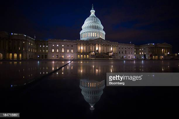 The US Capitol stands illuminated at night in Washington DC US on Tuesday Oct 15 2013 The House scrapped a vote tonight on a fiscal plan that...