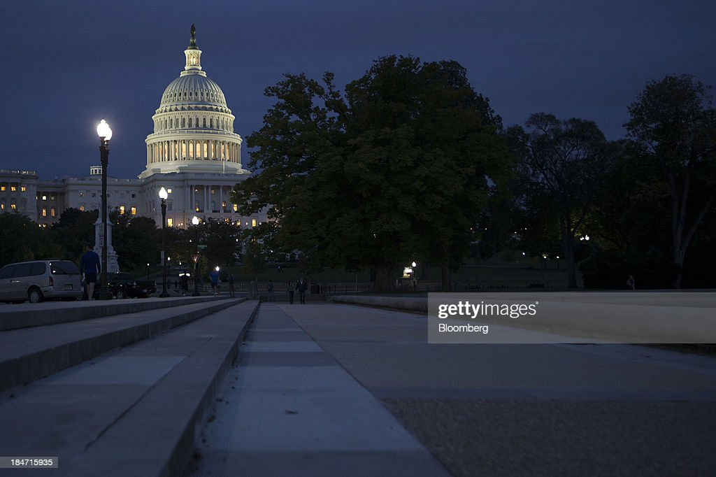 The U.S. Capitol stands illuminated at night in Washington, D.C., U.S., on Tuesday, Oct. 15, 2013. The House scrapped a vote tonight on a fiscal plan that contains almost none of Republicans' initial conditions for ending the 15 day-old government shutdown and raising the debt ceiling said Representative Pete Sessions, chairman of the House Rules Committee. Photographer: Andrew Harrer/Bloomberg via Getty Images