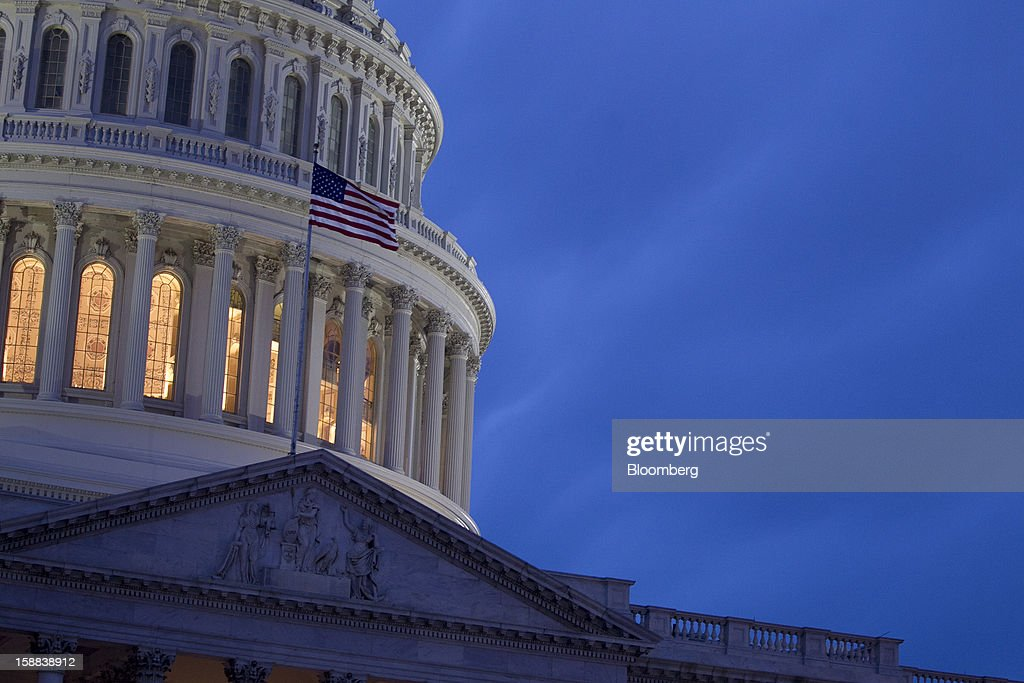 The U.S. Capitol stands in Washington, D.C., U.S., on Monday, Dec. 31, 2012. The U.S. House of Representatives doesn't plan any votes on the federal budget tonight, meaning that Congress for now will fail to avert $600 billion in tax increases and spending cuts set to start at midnight. Photographer: Andrew Harrer/Bloomberg via Getty Images