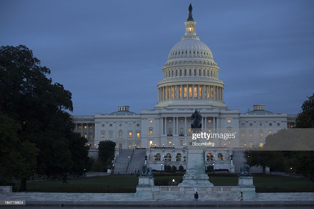 The U.S. Capitol stands in Washington, D.C., U.S., on Tuesday, Oct. 15, 2013. The House scrapped a vote tonight on a fiscal plan that contains almost none of Republicans' initial conditions for ending the 15 day-old government shutdown and raising the debt ceiling said Representative Pete Sessions, chairman of the House Rules Committee. Photographer: Andrew Harrer/Bloomberg via Getty Images
