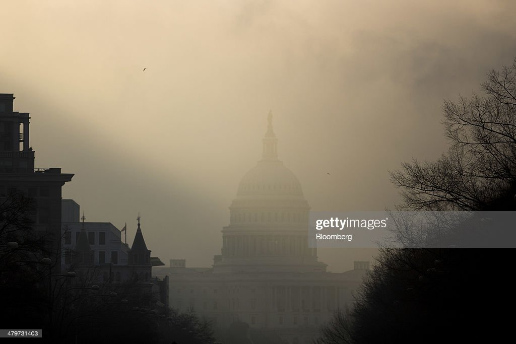 The U.S. Capitol stands surrounded by fog in Washington, D.C., U.S., on Thursday, March 20, 2014. Dozens of tax breaks that lapsed Dec. 31 would be revived in a plan to be presented soon by the new chairman of the U.S. Senate Finance Committee. The committee probably will hold a vote during the week of March 31, said a Democratic aide to the panel. Photographer: Andrew Harrer/Bloomberg via Getty Images