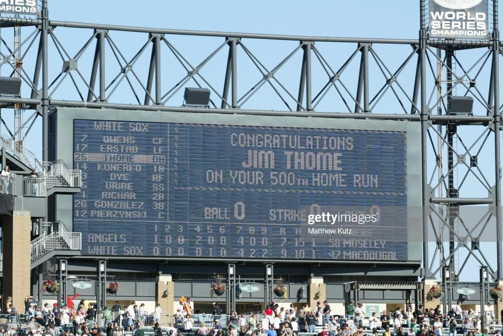 The US Cellular Field scoreboard shows a video presentation for designated hitter Jim Thome of the Chicago White Sox who hit his 500th career homerun...