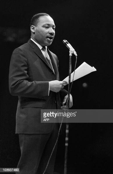 The US clergyman and civil rights leader Martin Luther King addresses 29 March 1966 in Paris' Sport Palace the militants of the 'Movement for the...