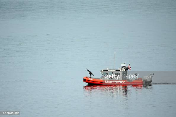 The US Coast Guard is seen in the Puget Sound during the first round of the 115th US Open Championship at Chambers Bay on June 18 2015 in University...