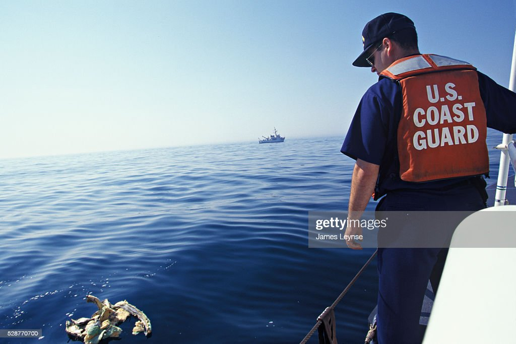 The US Coast Guard picks up debris at the scene of the crash of TWA flight 800