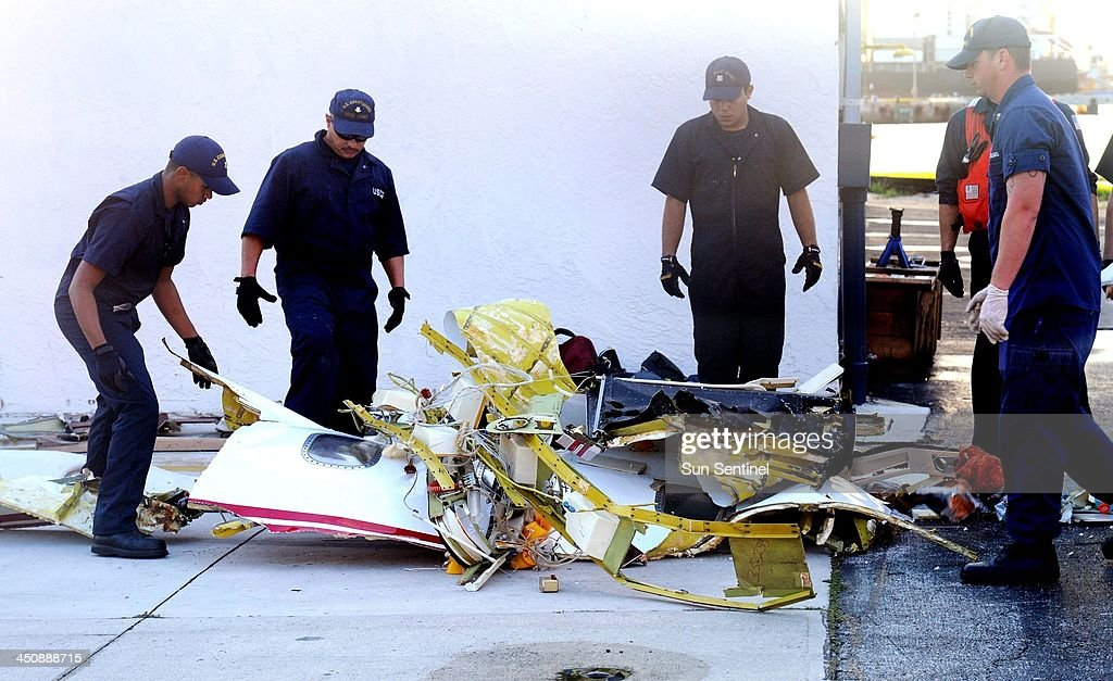 The U.S. Coast Guard unloads pieces of the Learjet 35 on Wednesday, Nov. 20, 2013, that crashed Tuesday in the Atlantic Ocean shortly after takeoff from Fort Lauderdale-Hollywood International Airport.