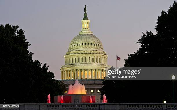 The US Congress building is seen at dusk on the eve of a possible government shutdown as Congress battles out the budget in Washington DC September...