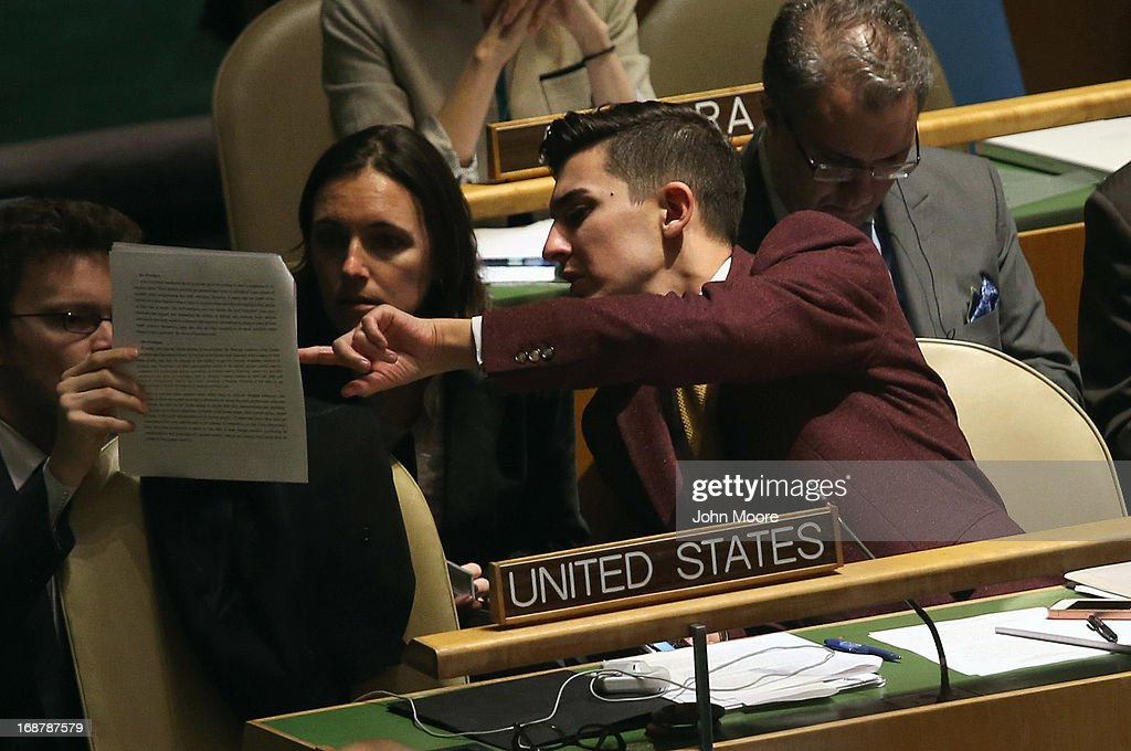 The U.S. delegation reads over a resolution ahead of a vote at the United Nations calling for a political transition in Syria on May 15, 2013 in New York City. The 193-member UN General Assembly was to vote on an Arab-backed resolution condemning the regime of Syrian President Bashar Assad for human rights abuses and its escalating use of heavy weapons in the country's civil war.