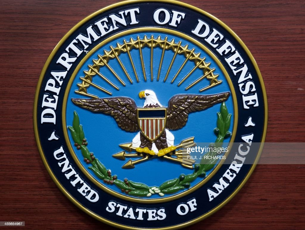 The US Department of Defense logo is seen on the lecturn in the media briefing room at the Pentagon December 12 2013 in Washington DC AFP Photo/Paul...