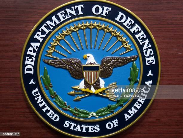 The US Department of Defense seal is seen on the lecturn in the media briefing room at the Pentagon December 12 2013 in Washington DC AFP Photo/Paul...